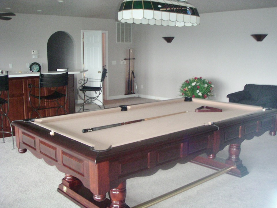 very large family room  with bar ample space for pool table and other games,  fireplace